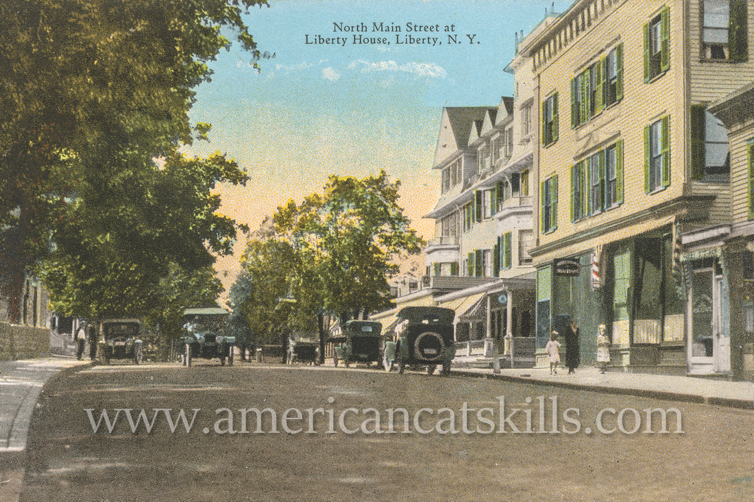 Vintage postcard from photographer Otto Hillig showing North Main Street in the village of Liberty in Sullivan County, New York.