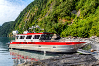 Photograph of the Lazy Otter Charters boat M/V Voyager at a water landing in Blackstone Bay near Whittier, Alaska.