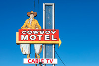 Vintage sign depicting an old-fashioned cowboy while advertising for the Cowboy Motel, an historic motor court located along Route 66 (East Amarillo Boulevard) in the city of Amarillo, Texas.