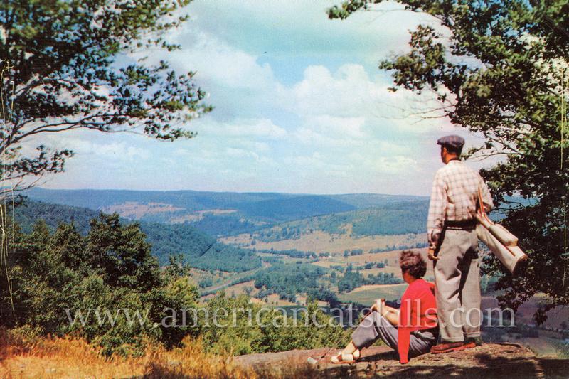 "Vintage postcard by photographer Bob Wyer titled ""Sunset Rock at Oquaga Lake."""