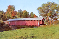 Vintage postcard of the historic Fitches Covered Bridge as it spans the Delaware River at East Delhi in Delaware County. New York.