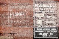 These side-by-side ghost signs, located in downtown Wheeling, West Virginia, advertise McGhee & Co. Office Supplies as well as exclusive piano sales.