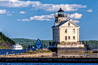 The beautiful Rondout Lighthouse is located along the Hudson River to mark the entrance and tidal flats of the Rondout Creek.